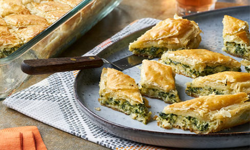 Spinach Pastry Diamonds plated next to serving dish